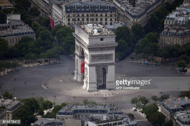 A picture taken on July 14 in Paris shows an aerial view of the Arc de Triomphe de l'Etoile standing located at the center of Place Charles de Gaulle...