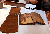 A picture taken on July 15 2015 shows leather scripts displayed during a ceremony at Iraq's National Museum where looted artefacts recovered by the...