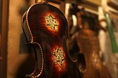A picture taken on July 15 2016 shows a violin which is part of a collection of old violins that were formerly owned by European Jews during the...