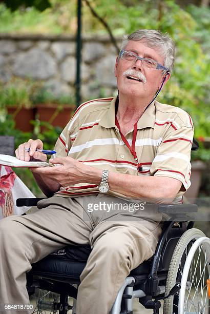 A picture taken on July 15 2016 shows former doctor and head of an association of patients suffering from multiple sclerosis Vladimir Komparic posing...