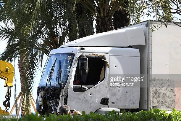TOPSHOT A picture taken on July 15 2016 shows the truck riddled with bullets that was driven by a man through a crowd celebrating Bastille Day being...