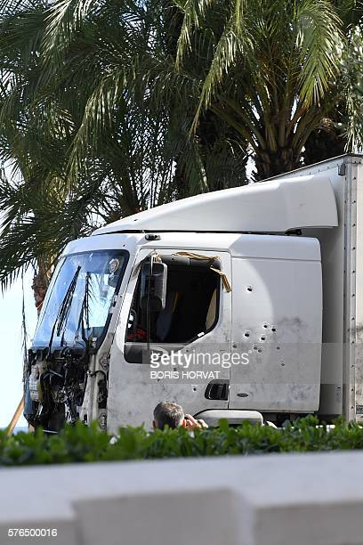 A picture taken on July 15 2016 shows the truck riddled with bullets that was driven by a man through a crowd celebrating Bastille Day being towed...