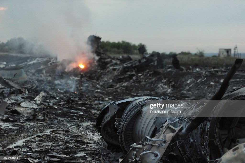 A picture taken on July 17 2014 shows wreckages of the malaysian airliner carrying 295 people from Amsterdam to Kuala Lumpur after it crashed near...