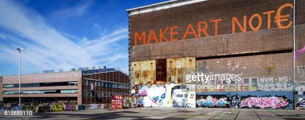 A picture taken on July 17 2017 shows a mural representing stricken Ajax midfielder Abdelhak Nouri and other graffitis at a former shipyard in...