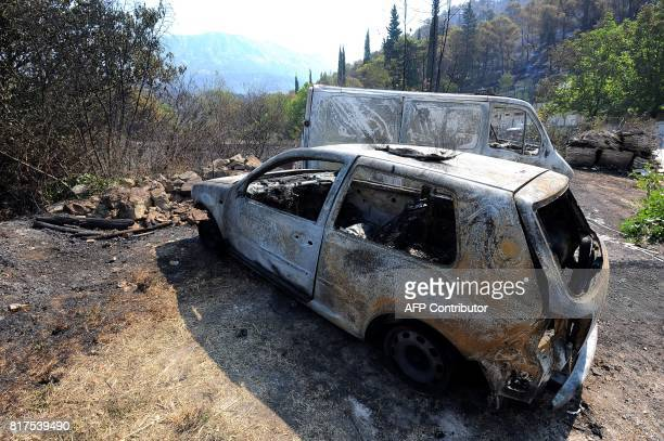 A picture taken on July 18 2018 shows burned cars in the village of Zrnovnica near the Adriatic coastal town of Split Montenegro asked on July 17 for...