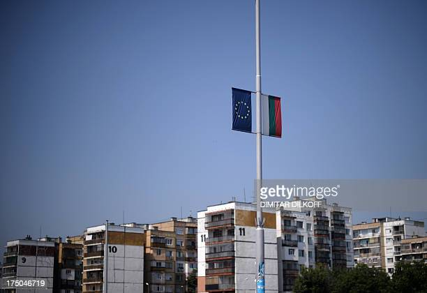A picture taken on July 18 shows the European Union and Bulgarian flags attached side by side to a street lampost in the town of Vidin near the...