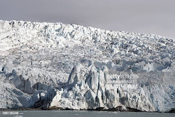 A picture taken on July 19 2015 shows a view of the Nordenskiold Glacier on the Spitsbergen island Norwegian archipelago of Svalbard northern Norway...