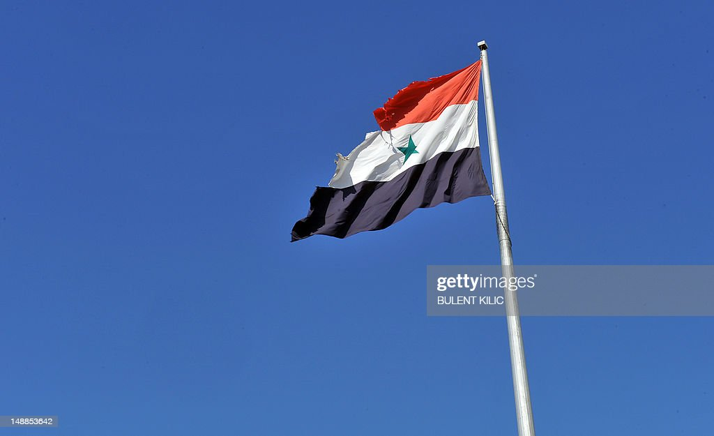 A picture taken on July 20, 2012 shows a torn flag flying at the Bab al-Hawa border post with Turkey. Syrian rebels seized control of the Bab Al-Hawa border post with Turkey today after a fierce battle with Syrian troops, an AFP photographer at the scene reported. Some 150 armed rebel fighters were in control of the post, which lies opposite Turkey's Cilvegozu border crossing in the southern province of Hatay.