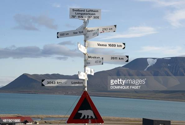 A picture taken on July 20 2015 shows a signpost and a polar bear warning sign at the Longyearbyen airport AFP PHOTO / DOMINIQUE FAGET