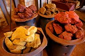 A picture taken on July 20 2016 at the headquarters of French company 'Le Moulin à couleurs' in Ecordal northern France shows natural pigments made...