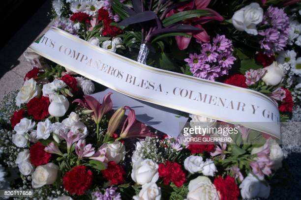 A picture taken on July 21 2017 shows a wreath of flowers on the grave of former head of Spanish bank Caja Madrid Miguel Blesa at the Virgen de...