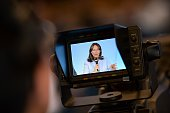 A picture taken on July 22 2016 shows a video camera filming the speech of French minister for Ecology Sustainable Development and Energy Segolene...