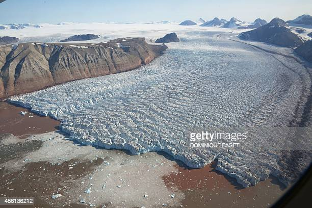 A picture taken on July 23 2015 shows a view of the Kronebreen Glacier on the Spitsbergen island Norwegian archipelago of Svalbard northern Norway...
