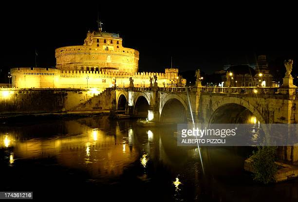 A picture taken on July 24 2013 at night shows the Castel Sant'Angelo in Rome Only open for a few months in the summer the Passetto di Borgo is an...