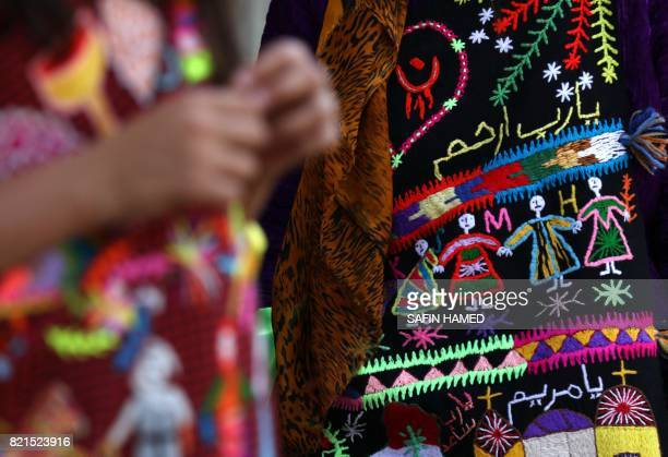 A picture taken on July 24 2017 shows a close up shot of an Iraqi Christian girl's traditional dress as she attends a mass at the Church of the...