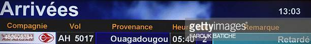 A picture taken on July 24 shows the 'delayed' status of flight AH 5017 from Ouagadougou to Algiers on the departure/arrival time flight board at the...