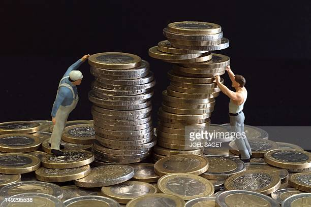 Picture taken on July 26 2012 in Paris shows an illustration made with figurines and euro coins Europe's economic crisis has deepened with a slump in...