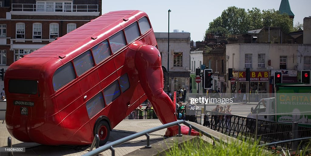 A picture taken on July 26, 2012 shows David Cerny's double-decker bus art installation 'London Booster'. The Czech artist has adapted a 1957 London bus and added huge mechanical arms which enable it to do press-ups. The work was commissioned by the Czech Olympic Committee, at Czech House.