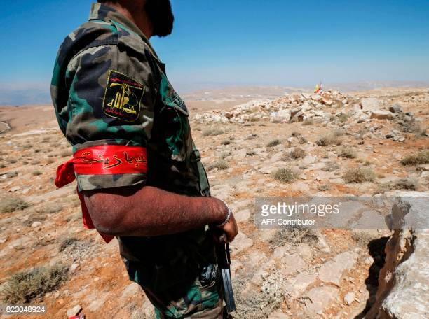 A picture taken on July 26 2017 during a tour guided by the Lebanese Shiite Hezbollah movement shows a fighter from the group standing in a...