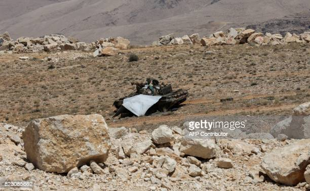 A picture taken on July 26 2017 during a tour guided by the Lebanese Shiite Hezbollah movement shows members of the group riding on a tank in a...