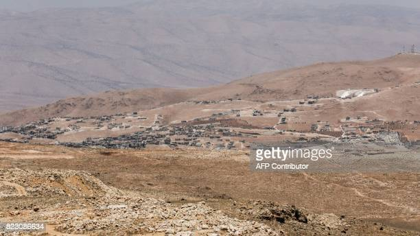 A picture taken on July 26 2017 during a tour guided by the Lebanese Shiite Hezbollah movement shows a general view of a camp for Syrian refugees...