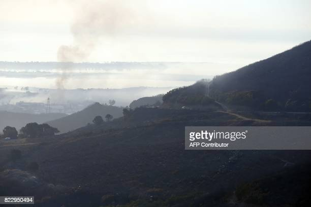 A picture taken on July 26 2017 shows devastated land following a fire in Biguglia on the French Mediterranean island of Corsica France asked for...