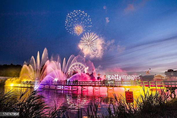 A picture taken on July 28 2013 shows fireworks over a water and light show during the third day of the 9th edition of the Tomorrowland music...
