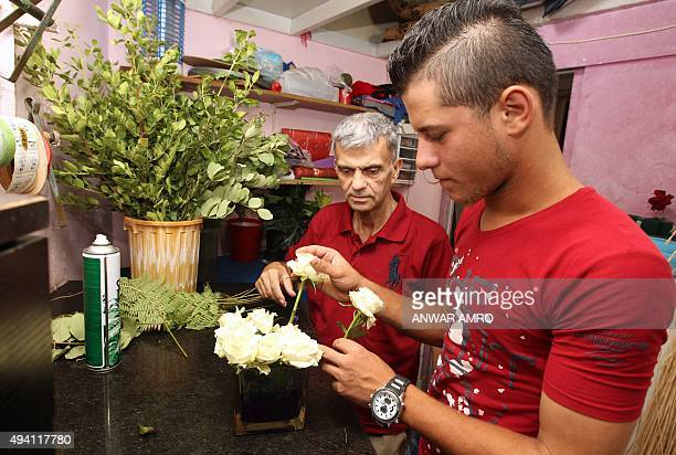 A picture taken on July 29 2015 shows 18yearold Syrian teenager Ibarhim arranging flowers at a flower shop in the Lebanese capital Beirut Ibrahim is...