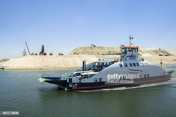 A picture taken on July 29 2015 shows a boat crossing the new waterway at the new Suez Canal in the Egyptian port city of Ismailia east of Cairo...
