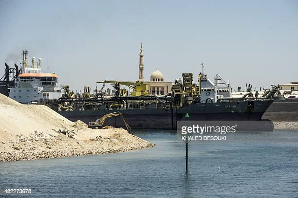 A picture taken on July 29 2015 shows the construction site at the new Suez Canal in the Egyptian port city of Ismailia east of Cairo Egypt began the...