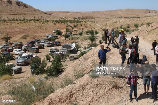 A picture taken on July 29 2017 during a tour guided by the Lebanese Shiite Hezbollah movement shows members of the media gathering in a mountainous...
