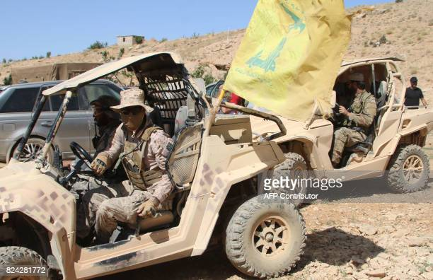 A picture taken on July 29 2017 during a tour guided by the Lebanese Shiite Hezbollah movement shows fighters of the group sitting in...