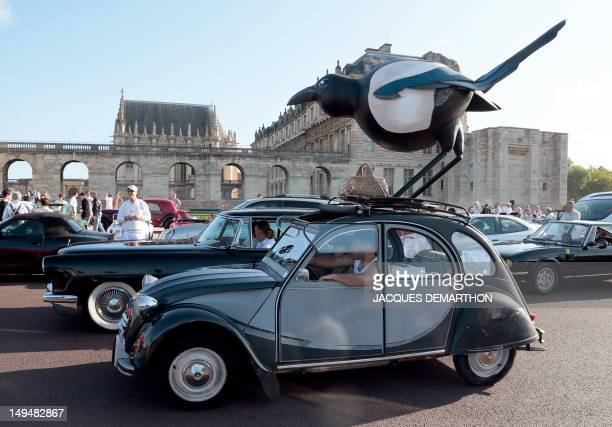 A picture taken on July 29 shows a decoration representing an magpie on a Citroen 2CV car in Vincennes outside Paris during a vintage cars parade as...