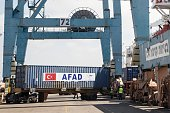 A picture taken on July 3 2016 shows containers being unloaded from Lady Leyla a humanitarian aid ship sent from Turkey to the Gaza Strip at the...