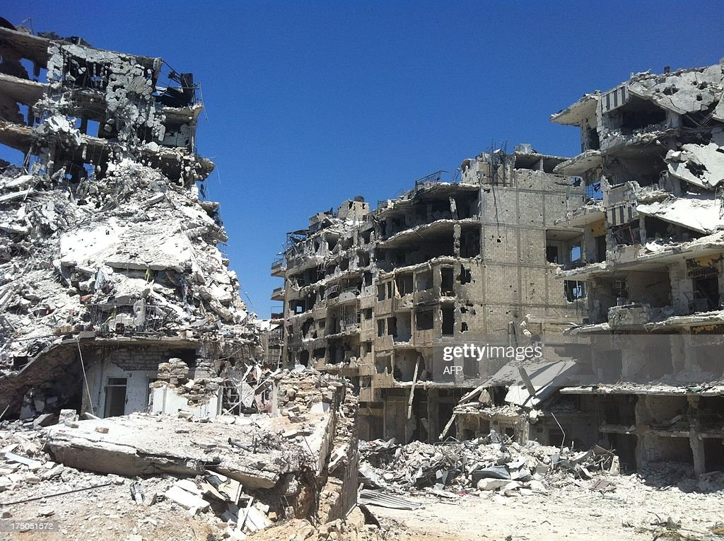 A picture taken on July 30 2013 shows damaged buildings in a street of the district of alKhalidiyah in the central Syrian city of Homs Seven children...