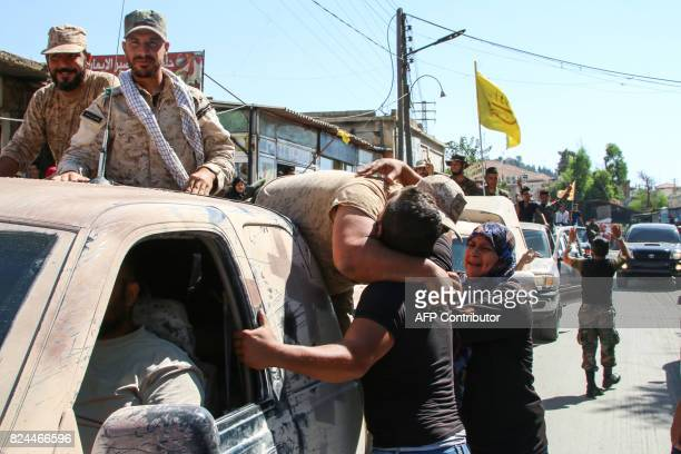 A picture taken on July 30 2017 in alLabweh village part of the BaalbekHermel governorate shows a member of the Lebanese Shiite Hezbollah movement...