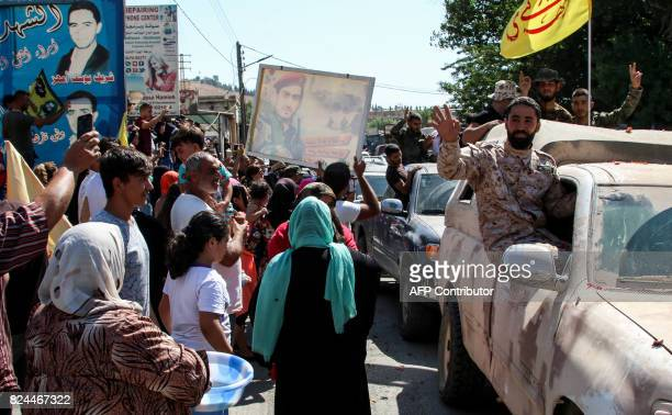 A picture taken on July 30 2017 in alLabweh village part of the BaalbekHermel governorate shows members of the Lebanese Shiite Hezbollah movement...