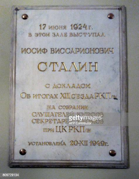 A picture taken on July 4 2017 shows a plaque in honor of late Soviet leader Joseph Stalin hanged on a wall of the Kutafin Moscow State Law...