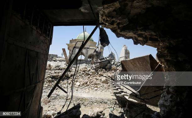 A picture taken on July 5 2017 shows a bulldozer parked outside the destroyed AlNuri Mosque in the Old City of Mosul during the Iraqi government...