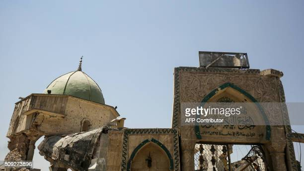 A picture taken on July 5 2017 shows the exterior of the destroyed AlNuri Mosque and its gate in the Old City of Mosul during the Iraqi government...