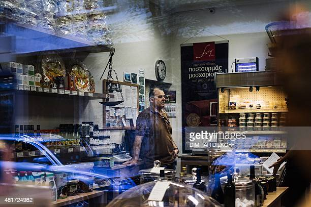 A picture taken on July 6 2015 shows Panagiotis Douvos standing in his Greek deli Bakalia in downtown Sofia Faced with a deep economic crisis at home...