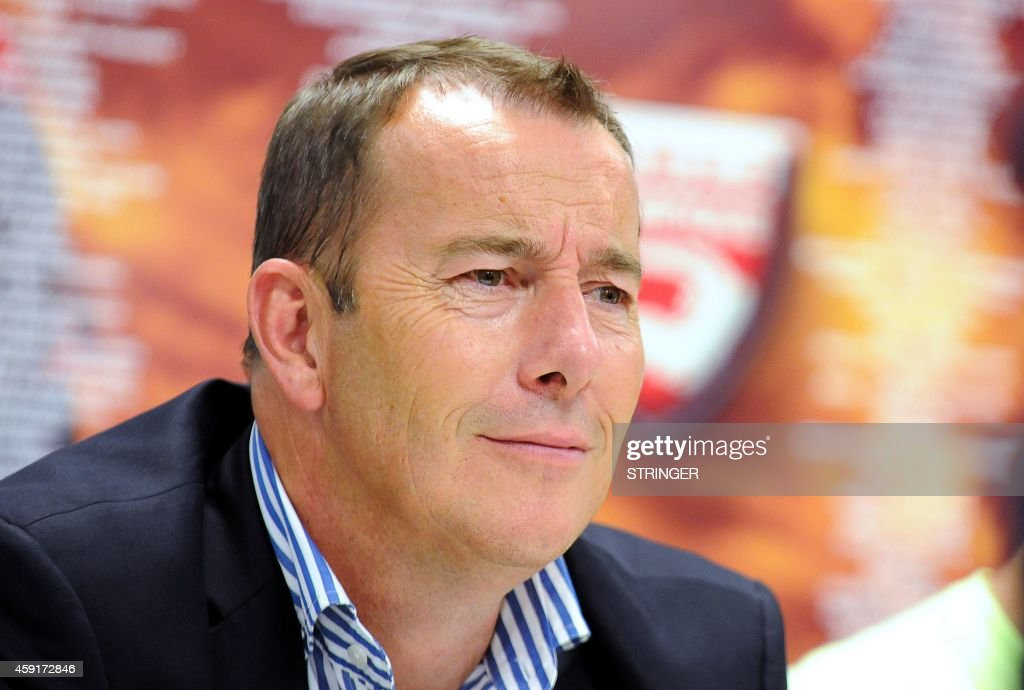 A picture taken on July 7 2014 shows president of French L2 football club Nimes Olympique JeanMarc Conrad speaking to the press in Nimes southeastern...