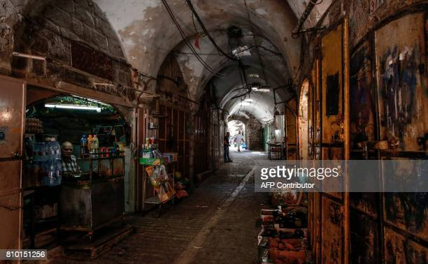 A picture taken on July 7 2017 shows a view of open shops in an alley of the old market of the divided West Bank city of Hebron On July 7 2017 UNESCO...