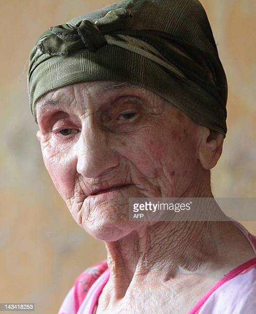 Picture taken on July 8 2010 shows Georgian woman Antisa Khvichava during her 130th birthday party in the village of Sachino some 370 km west of...