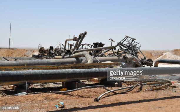 A picture taken on July 9 2017 shows the damage at Syria's Arak gas field 35 kilometres northeast of the ancient city of Palmyra in the central...