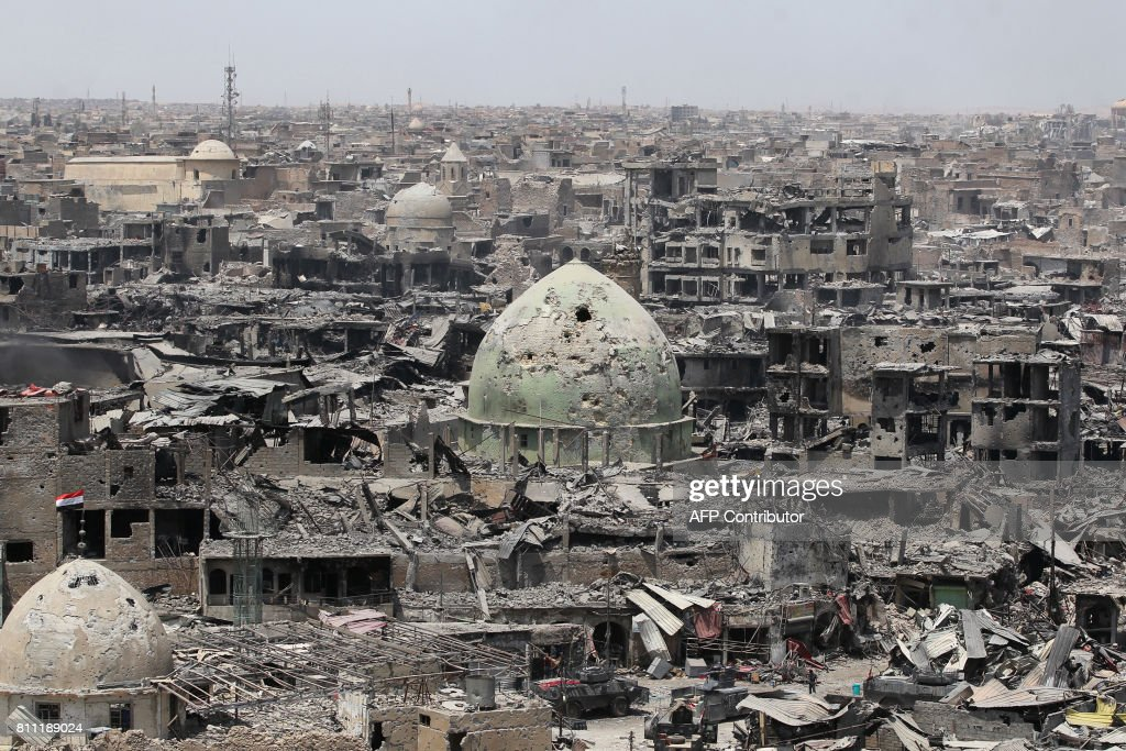 TOPSHOT - A picture taken on July 9, 2017, shows a general view of the destruction in Mosul's Old City. Iraq will announce imminently a final victory in the nearly nine-month offensive to retake Mosul from jihadists, a US general said Saturday, as celebrations broke out among police forces in the city. /