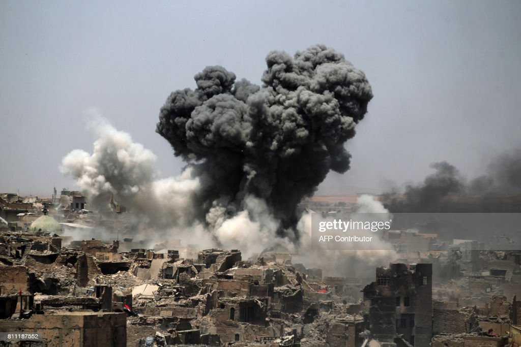 A picture taken on July 9, 2017, shows smoke billowing following an airstrike by US-led international coalition forces targeting Islamic State (IS) group in Mosul. Iraq will announce imminently a final victory in the nearly nine-month offensive to retake Mosul from jihadists, a US general said Saturday, as celebrations broke out among police forces in the city. /