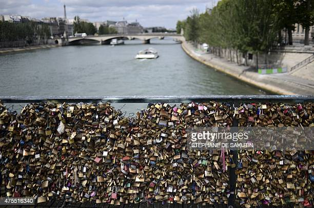 A picture taken on June 1 2015 shows 'love padlocks' before being removed on the railings of the Pont des Arts in Paris Started by tourists in Paris...