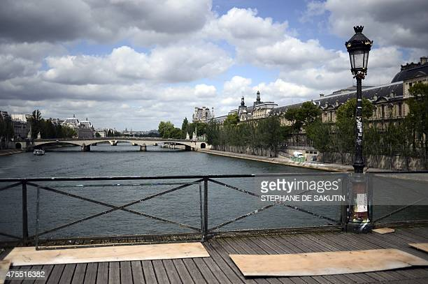 A picture taken on June 1 2015 shows the railings of the Pont des Arts after the 'love padlocks' were removed in Paris Started by tourists in Paris...