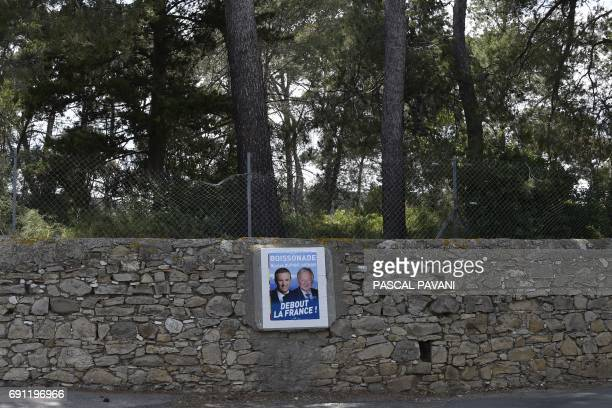 A picture taken on June 1 2017 shows an electoral poster of Former French presidential election candidate for the rightwing Debout la France party...